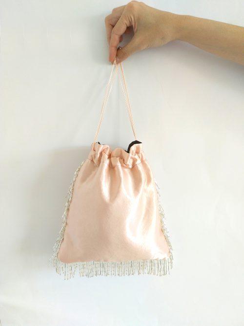 bolso rosa palo flecos